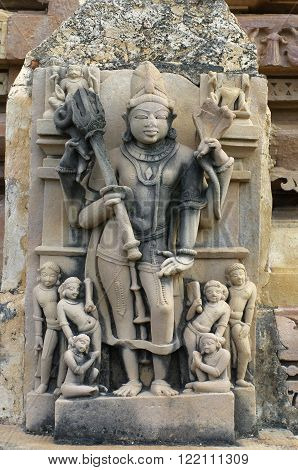 Stone carved relief in Hindu temple in Khajuraho India. Unesco World Heritage Site