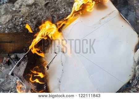 Burning Office White Paper In Bonfire