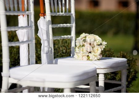 White chairs for the wedding ceremony outdoors
