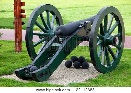 Old artillery gun with nuclei in the park