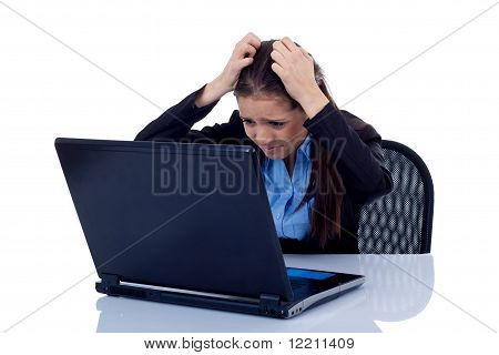 Business Woman Reading Bad News At Laptop