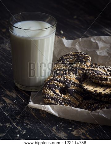 Milk and Cookies on a dark wood background