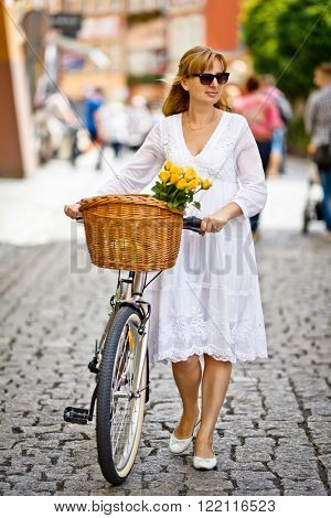 Urban biking - woman and bike in city