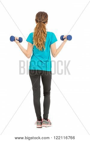 Full length fitness woman rearview lifting dumbbells