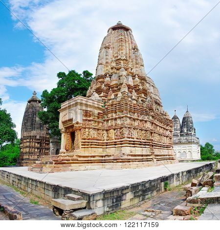 Hindu temple in Khajuraho India with Stone carved erotic bas reliefs. Unesco World Heritage Site