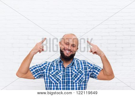 Casual Bald Bearded Business Man Smiling Point Fingers Up Head Office White Brick Wall