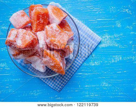 Sliced frozen pumpkin in a glass bowl