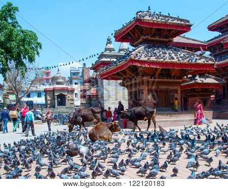 KATHMANDU, NEPAL - APRIL 4, 2014: People near temples on Durbar square, Kathmandu, Nepal.