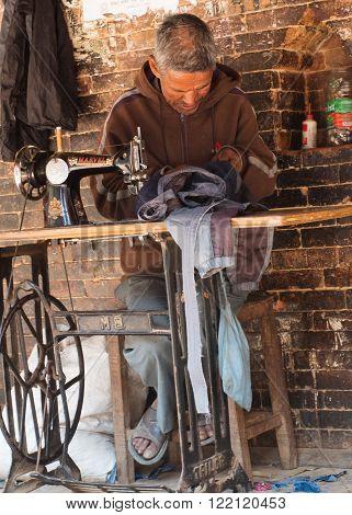 KATHMANDU - APRIL 5, 2014: Street tailor on the street in Bhaktapur, Kathmandu , Nepal.