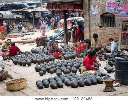 Nepalese People Working In The Her Pottery Workshop