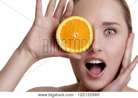 Beautiful Happy Girl Showing A Juicy Orange