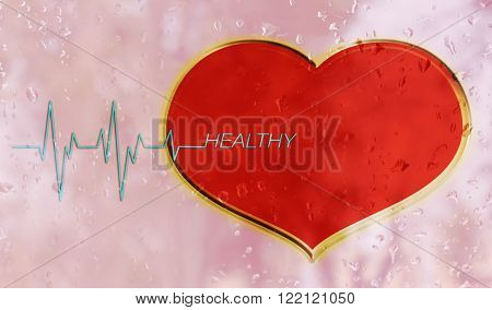Red heart on water drop mirror with pulse or heart beat and text healthy on for health background with copy space
