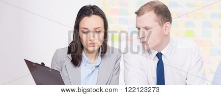 Picture of two workmates focused in the office