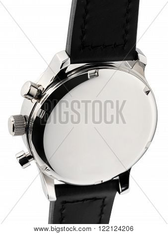 Close up view of the back of a silver metal wristwatch case with black strap isolated on white