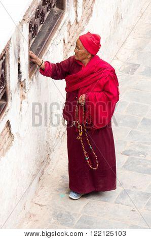 Nepalese People  Walking Around  Boudhanath Stupa  In Kathmandu.