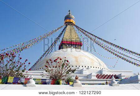 Buddhist Boudhanath Stupa in Kathmandu Nepal. Blue sky.