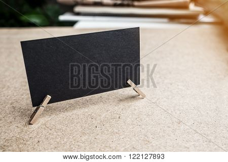 Black textured business card on clothes pin