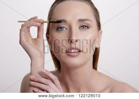 Closeup Beautiful Woman With Eyebrow Brush Tool