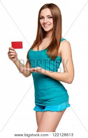 Teen bright girl showing blank credit card isolated on white background
