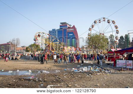 KATHMANDU NEPAL - MARCH 03: People in amusement park in Kathmandu Nepal on March 03 2014. Nepal is as one of the least developing country in the world in United Nations list.