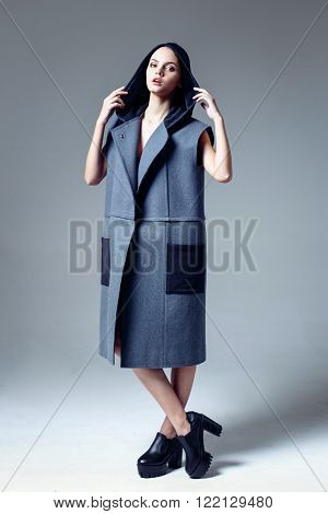 Beautiful young woman dressed in a coat