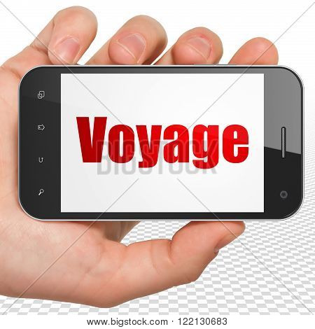 Travel concept: Hand Holding Smartphone with Voyage on display