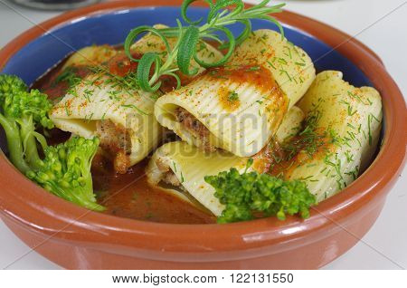 stuffed pasta with rosemary and broccoli in sauce