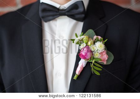 Boutonniere Pinned On Man In Black Suit