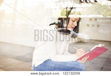 Asian Lady Writing Notebook Diary Concept