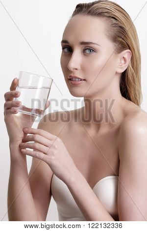 Young Beautiful Woman Drinking Fresh Water On White