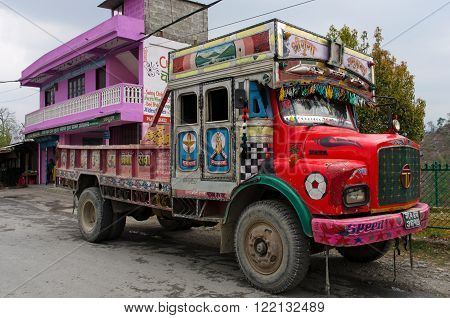 POKHARA, NEPAL - MARCH 30, 2014: Nepalese colorful truck on the road on March 30, 2014, in Pokhara, Nepal.