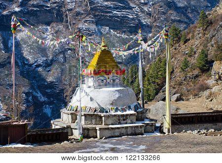 NAMCHE BAZARNEPAL-MARCH 5: View on Namche Bazar and buddist stupa on March 5 2014 Khumbu district Himalayas Nepal