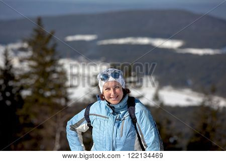 A smiling woman on the track of