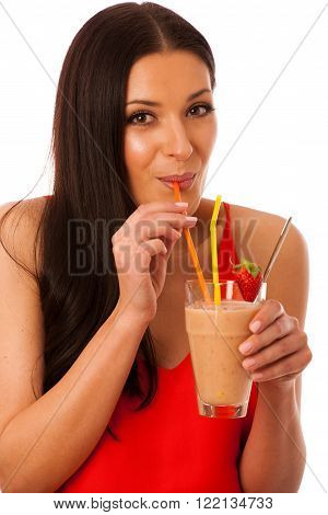 Woman drinking healthy fresh fruit smoothie decorated with red strawberry isolated over white.