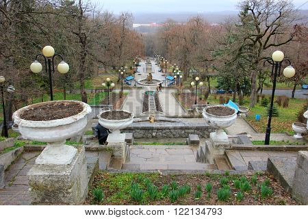 the cascade stairs in the Park of the city of Zheleznovodsk, stairs leading down, vases for flowers, lanterns, benches for resting