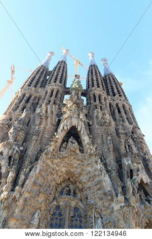 Barcelona, Spain - November 10, 2015: Nativity facade at Sagrada Familia with towers. The church is designed by architect Antoni Gaudi and is still under construction. 