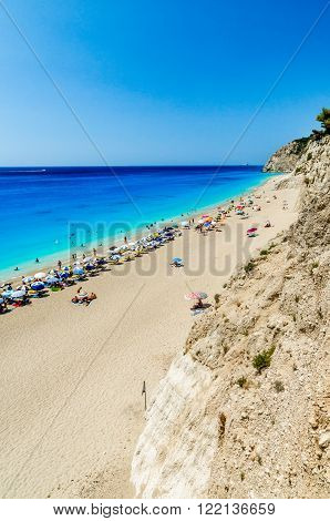 EGREMNI BEACH, LEFKADA ISLAND, GREECE - JULY 16 2015: People relaxing at the beach. Egremni beach was destroyed by earthquake in autumn of 2015. The photo was taked o couple of months before.