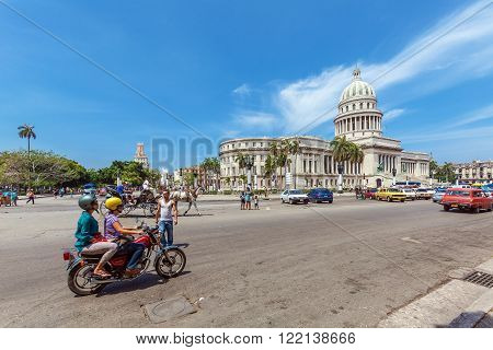 Havana, Cuba - April 1, 2012: Heavy Traffic With Horse Carriages, Motorbikes And Cars In Front Of Ca