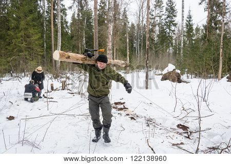 Tourists In The Forest For Harvesting Wood For The Fire, March 13, 2016.