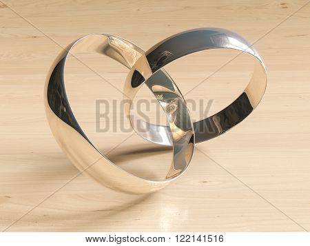 Two wedding rings  on wooden background