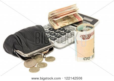 a bit Russian money and the calculator on a white background
