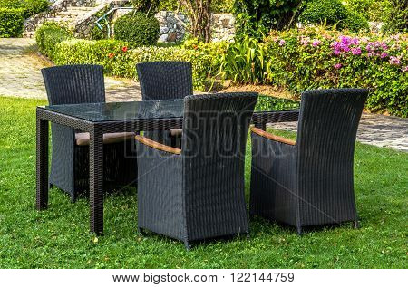 Rattan furniture, table and chairs, cushion  outdoors