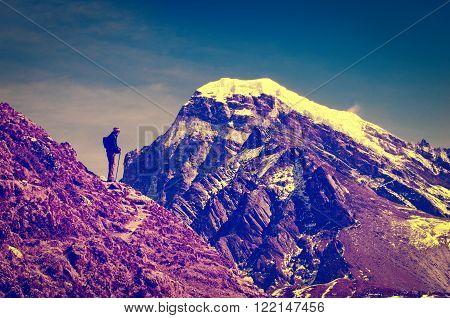 Tourist in mountains in Sagarmatha National Park Nepal Himalayas. Instagram toning effect.