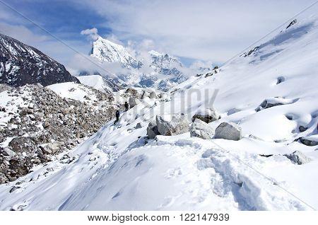 Hiking group on a trail. Ngozumba Glacier Sagarmatha National Park Nepal Himalayas