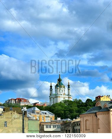 Golden Domes of Saint Andrew's Church in Kiev against the dramatic sky. The capital of Ukraine - Kyiv.