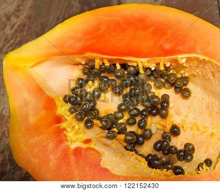 fresh ripe juicy papaya slice on wooden background