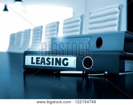 Leasing - Ring Binder on Wooden Desktop. Leasing. Business Illustration on Blurred Background. Ring Binder with Inscription Leasing on Black Desktop. 3D Render.