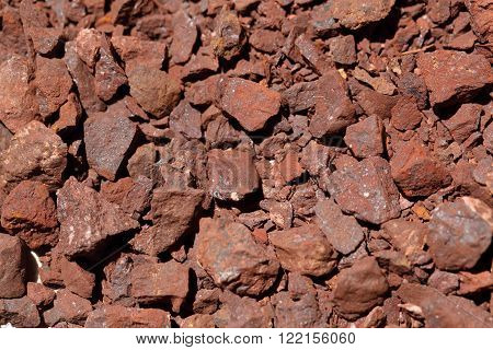 A macro photo of red crushed iron ore.