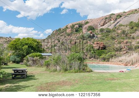 MOUNTAIN ZEBRA NATIONAL PARK, SOUTH AFRICA - FEBRUARY 18, 2016: The swimming pool at the main camp in the Mountain Zebra National Park near Cradock