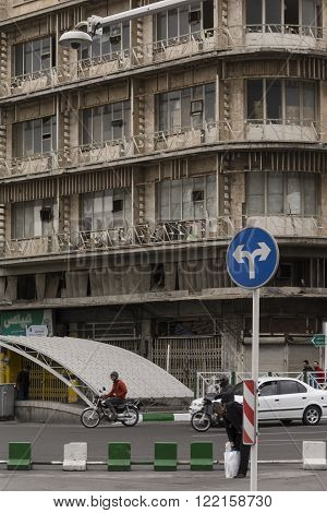 Tehran Province- IRAN-March 17 2016 Driving Blue Both Direction Sign in Front of An Old Building